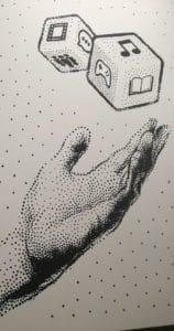 Ręka podrzucająca kostki